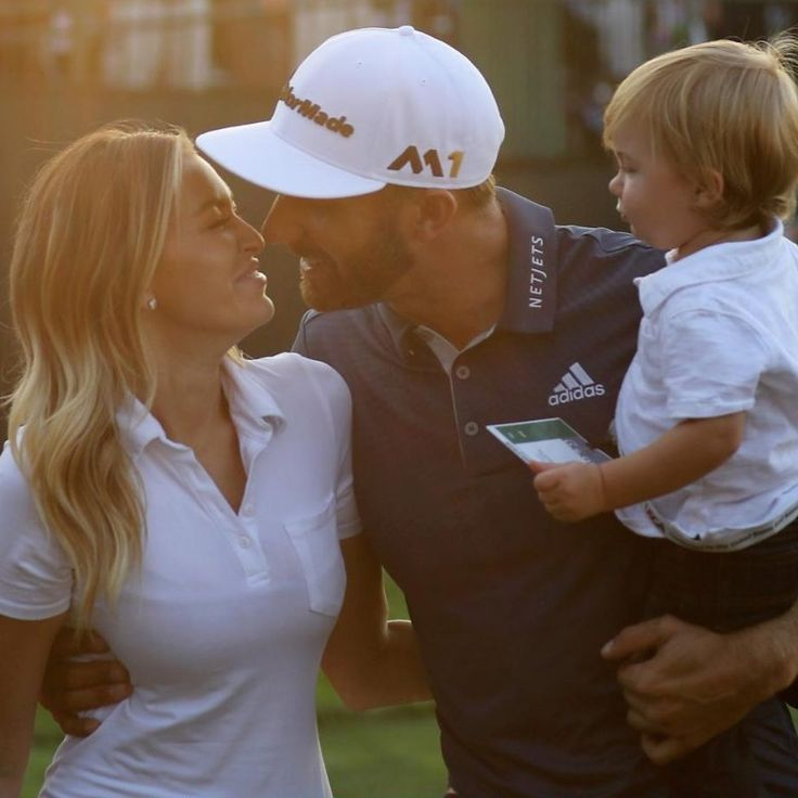 Dustin Johnson of the United States celebrates with partner Paulina Gretzky and son Tatum after winning the U.S. Open at Oakmont Country Club in Oakmont, Pennsylvania
