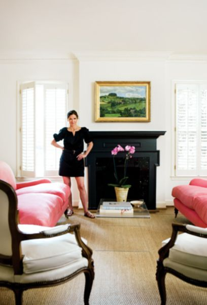ann-mashburn-atlanta-home-store | lovely room with pops of pink | love the white walls with black fireplace | a cheerful room!