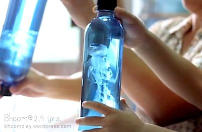 This is one of the coolest things I've seen in awhile!   BhoomPlay shows you how to make this fascinating   jellyfish in a bottle using a plastic bag. I think this would   be a great party favor for a an ocean-themed party!
