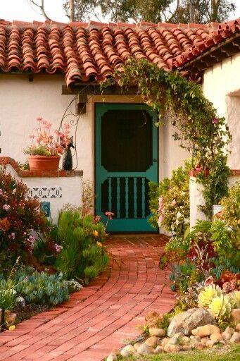Spanish Style Home Green Screen Door And Garden