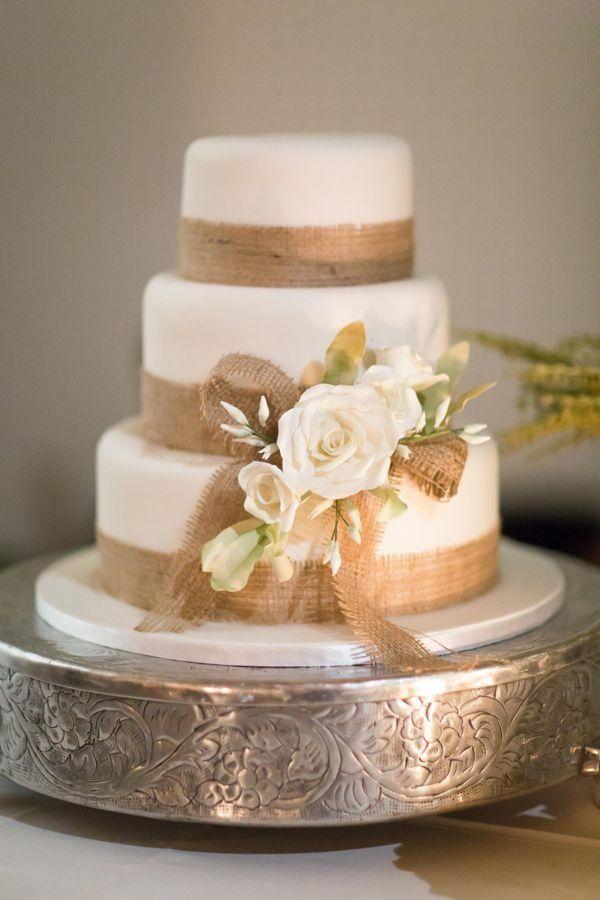 Rustic wedding cake with burlap trim / http://www.deerpearlflowers.com/rustic-country-burlap-wedding-cakes/