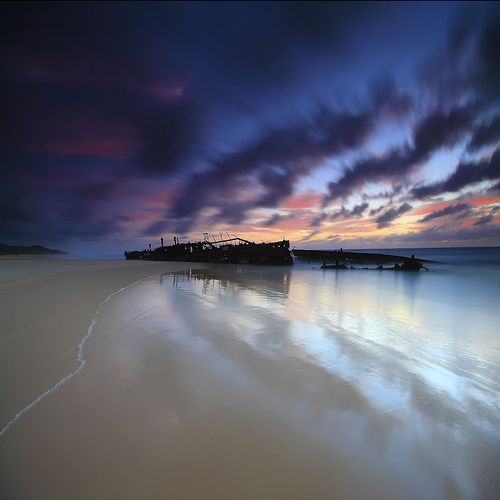 Fraser Island is the largest sand island in the world. The image features a shipwreck of the Maheno spirit built in Dumbarton Scotland.