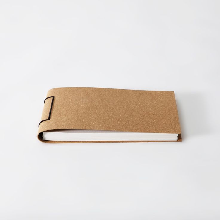 Recycled paper in a recycled leather cover. Simple, functional and based on a traditional Japanese book binding technique. The leather has a textural and highly durable quality. Plain white paper. A5 size.