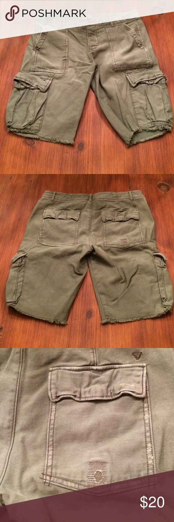 Military style cargo shorts American Eagle cargo shorts. Size 4. Stitching on some of the pockets made to look distressed. In great shape, no holes or stains. Knee length American Eagle Outfitters Shorts Cargos