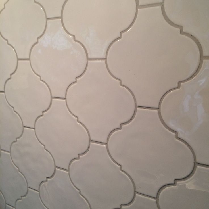 Chose this white gloss lantern tile. Perfect shape. From CIOT