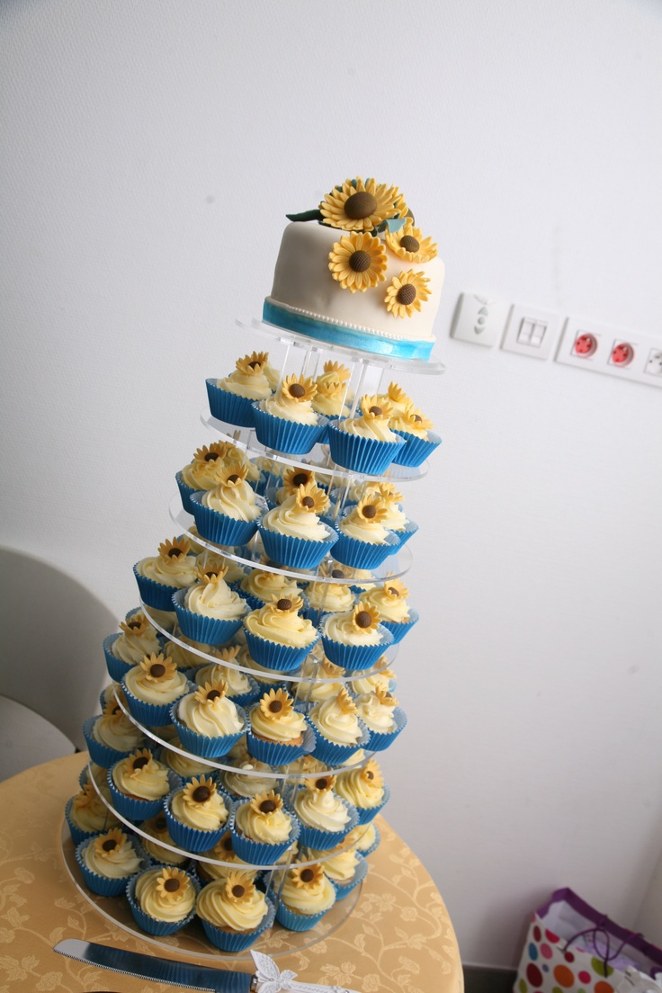 Use Real Flowers On The Top And Navy Cupcake Liners To Incorporate Darker Color