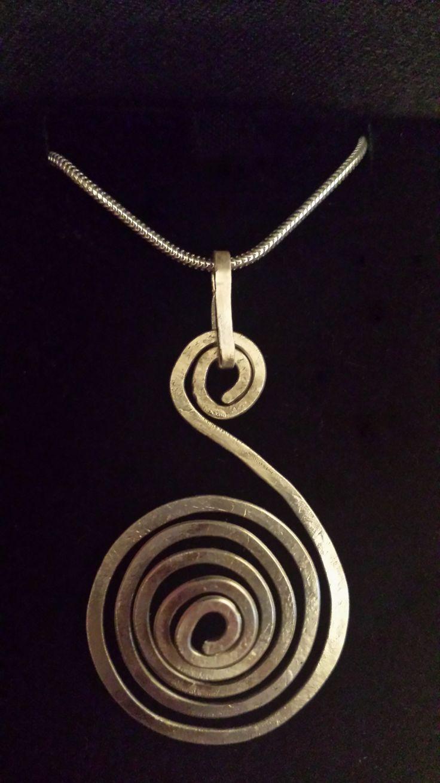 Hammered silver spiral pendant