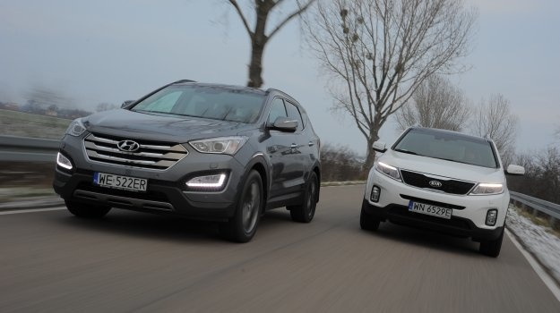 Wyglądają, jakby nie miały ze sobą nic wspólnego, ale pod wieloma względami są identyczne. Nowa generacja Hyundaia Santa Fe staje do pojedynku z Kią Sorento po liftingu.