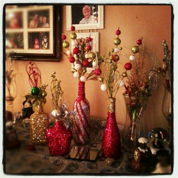 DIY Christmas decorations. Old wine/liquor bottles rolled in glitter!
