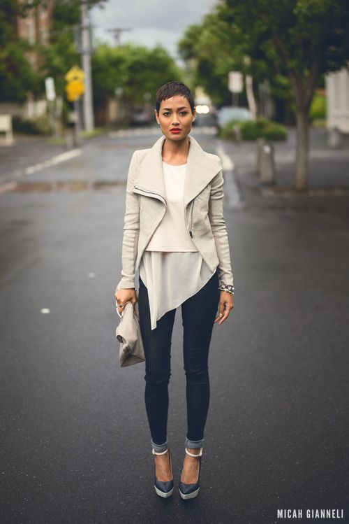 Shop this look for $148:  http://lookastic.com/women/looks/cropped-sweater-and-biker-jacket-and-tunic-and-skinny-jeans-and-heels-and-clutch/2328  — White Cropped Sweater  — Grey Leather Biker Jacket  — White Chiffon Tunic  — Navy Skinny Jeans  — Navy Leather Pumps  — Grey Leather Clutch