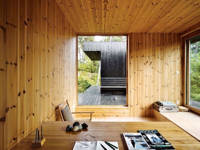 An architect recasts a 1960s artist's retreat in southeastern Norway. The 1950s desk in the office is from the original house; the chair is by Aksel, a Norwegian furniture company. Photo by Ivan Brodey. Photo by: Ivan BrodeyCourtesy of: Ivan Brodey