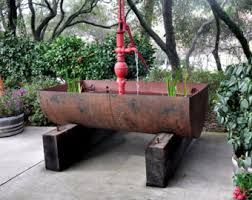 rustic garden feature using a 44 gallon drum