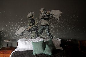 A Banksy mural at one of the bedrooms of Banksy's Walled-Off Hotel in Bethlehem
