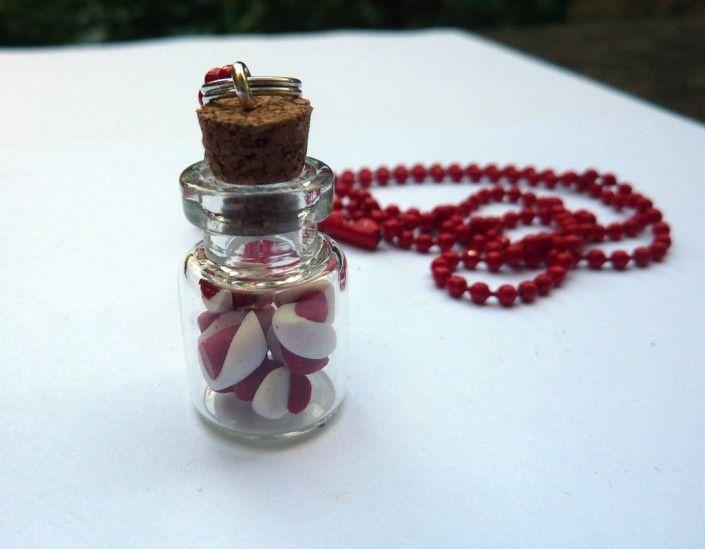 Glass bottle pendant with red and white #candy canes  in #polymer #clay #handmade - Ciondolo con bottiglietta con bastoncini di zucchero bianchi e rossi in fimo fatto a mano