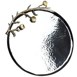 """Hammered stainless steel tray with a brass leafy branch detail.       Product: Tray  Construction Material: High quality stainless steel and brass Color: Silver and gold   Features:  Hammered accents    Two tone leaf design       Dimensions: 11.5 Diameter x 0.75"""" D      Cleaning and Care: Buff by hand"""