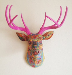 decoupaged deer head- i think the pink would go well in our dinning nook.