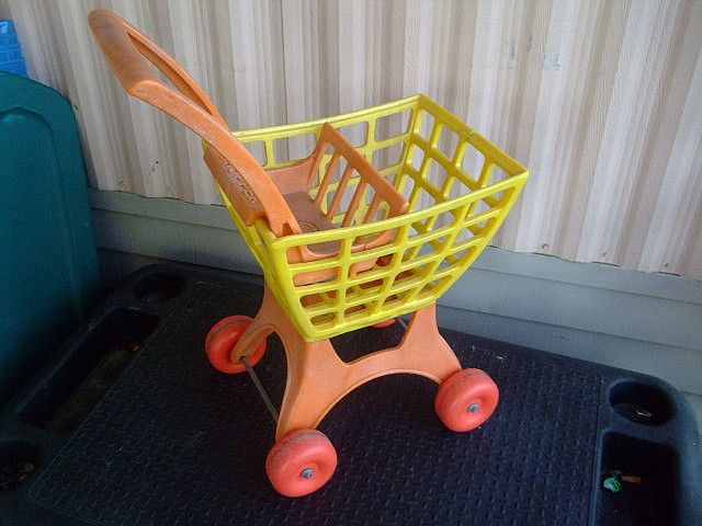 Old Toy Cart made of the sturdy stuff you just don't see any more. Probably bad for the environment. Grade 7 plastic?