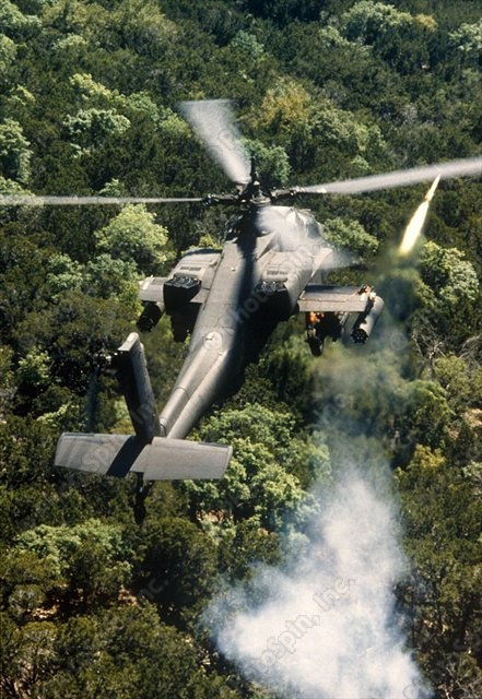 Apache Helicopter Firing | Royalty Free Stock Photo of Apache helicopter firing: PhotoSpin