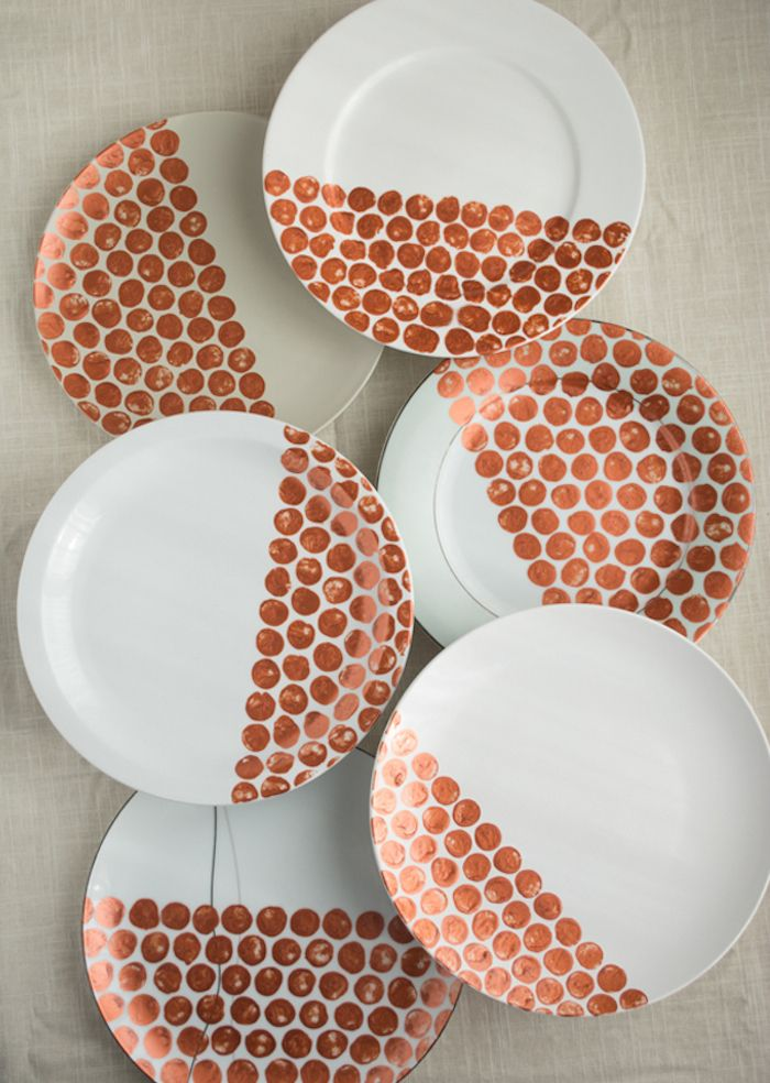 Turn $1 plates from your local thrift store into a gorgeous dinnerware set, just in time for the holidays!