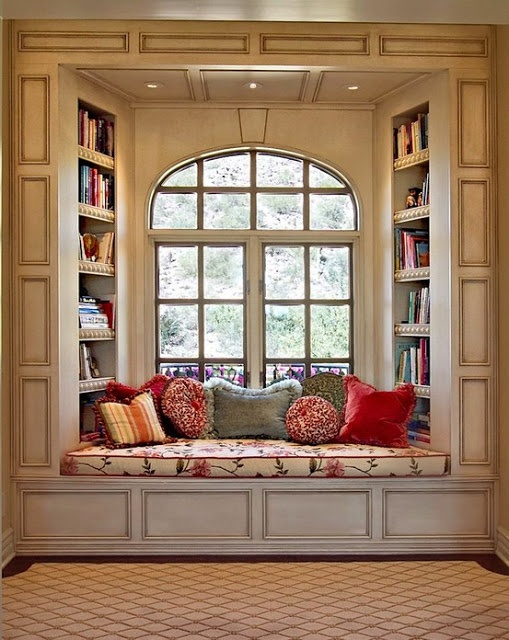 My home will have a room like this.. Ive always wanted a window seat.