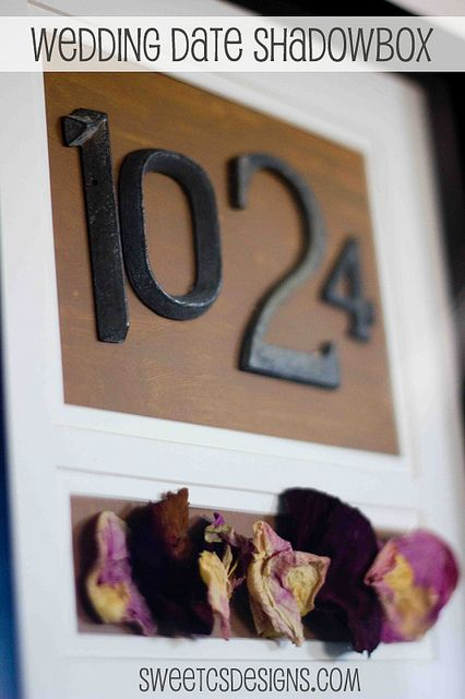 I LOVE THIS!!!!!! So doing this today Save a few trinkets from your wedding and make a shadowbox with house numbers to remind you of the special date. We love this as a first anniversary project.