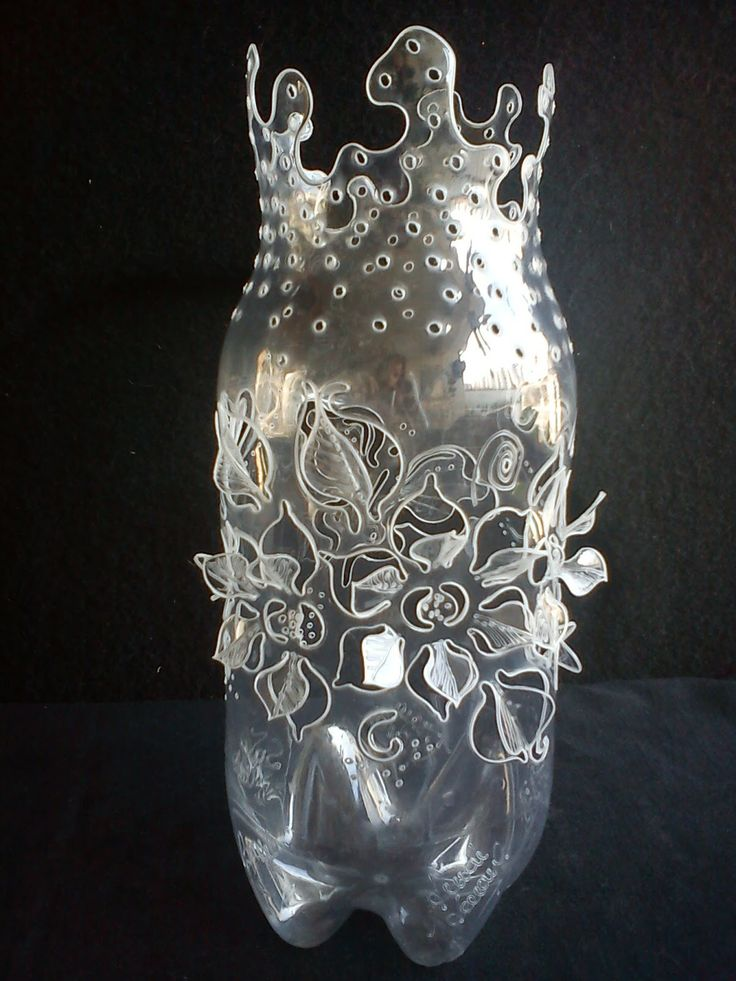 Recycled bottles into art...kids and exacto knives?