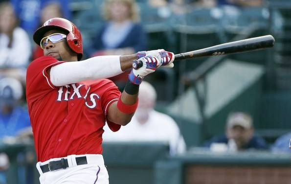 Texas Rangers Elvis Andrus watches his hit goes for an RBI double, scoring Delino DeShields, during the first inning of a baseball game against the Boston Red Sox, Saturday, May 30, 2015, in Arlington, Texas. (AP Photo/Brandon Wade)