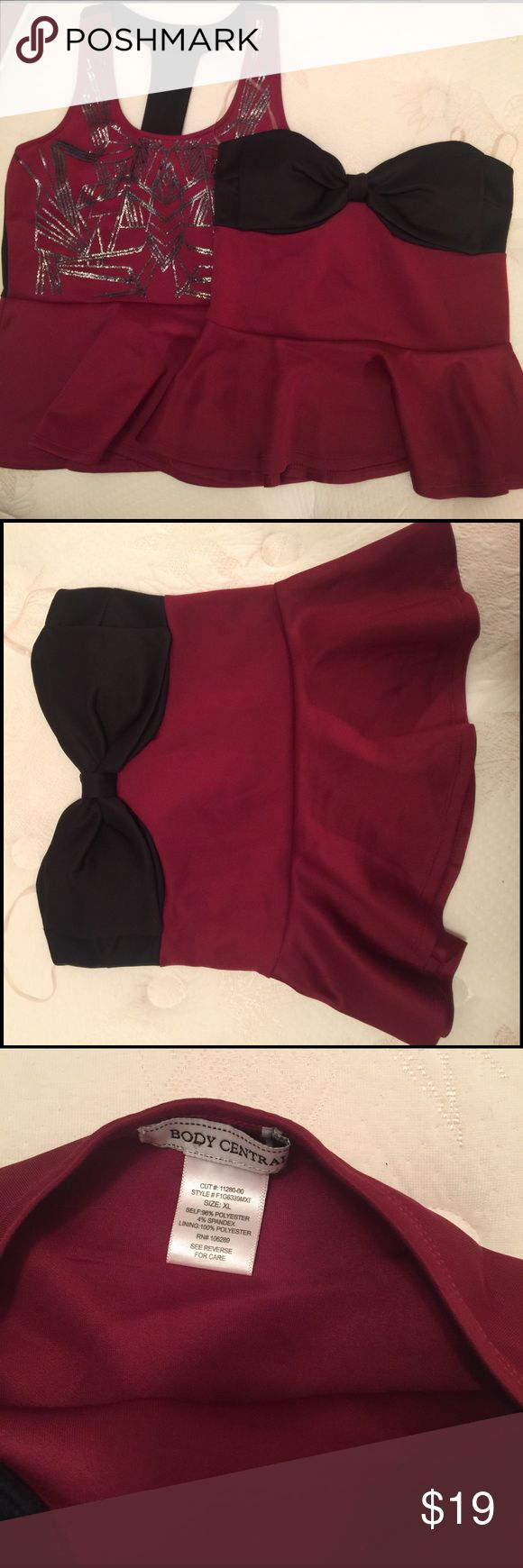 Body Central 2 Crop Tops Black and Garnet sz: Xl Body Central 2 Crop Tops Black and Garnet sz: Xl 1 has a bow and is Strapless the other one has black design on front and a t back. They both have a ruffle bottom. Never worn! Super cute! make an offer ❤ Body Central Tops Crop Tops