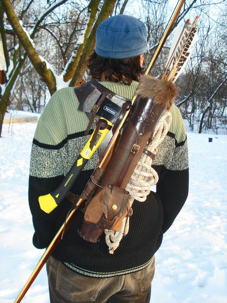 Multifunctional Tooled Leather Quiver Holding a Bow, an Axe, a Knife and a Rope with a Detachable Pouch. $300.00, via Etsy.