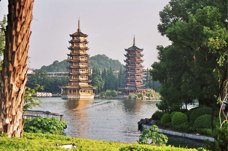 The Sun and Moon Pagodas are located on Banyan Lake in Guilin, China. The taller of the two, at nine storeys high, the Sun pagoda is the tallest copper pagoda in the world.