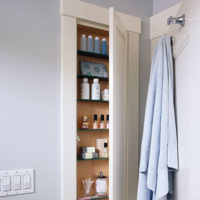 bathroom door is a perfect place for a cabinet of recessed shelves