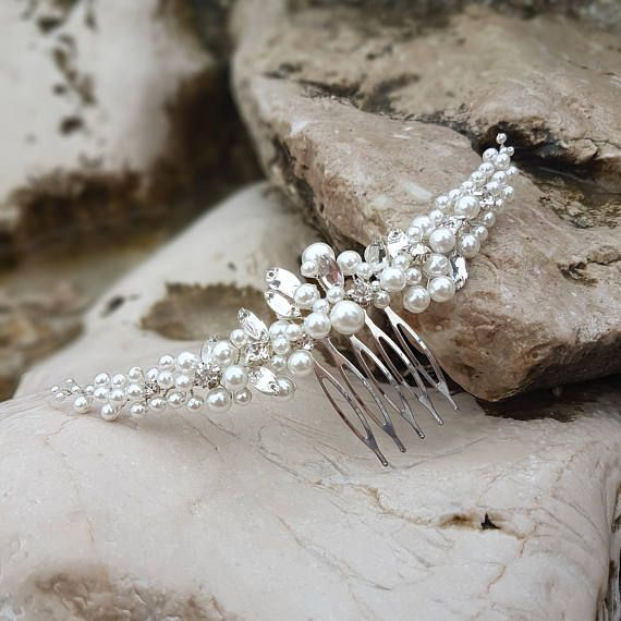 Check out this item in my Etsy shop https://www.etsy.com/listing/546331764/pearl-bridal-comb-vine-bridal-comb