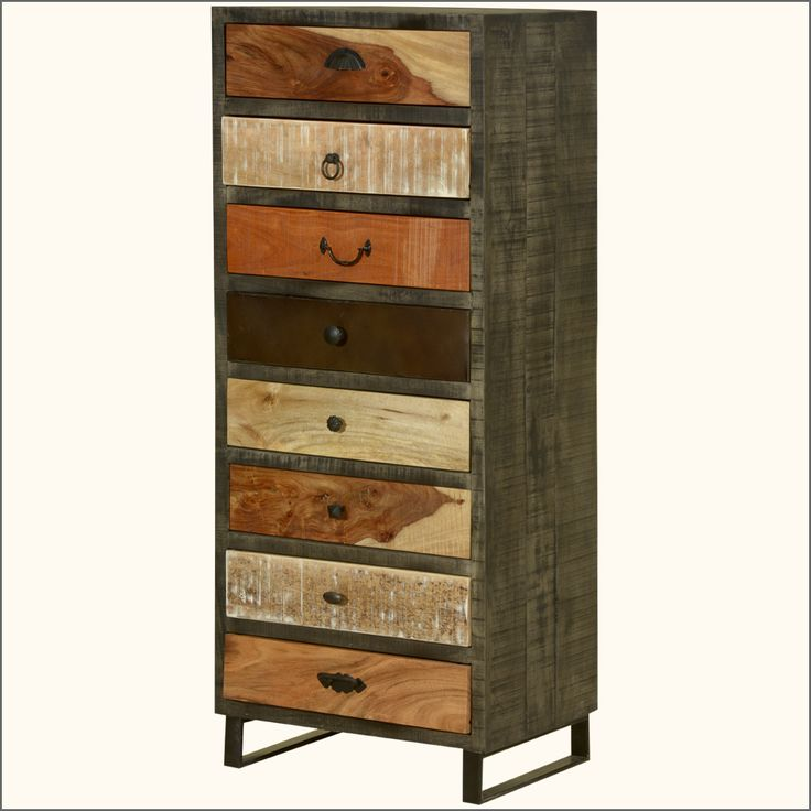"""This fusion style dresser combines the rustic beauty of various natural colors with the industrial style using an iron frame. Our Wooden Patches Chest of 8 Drawers Dresser measures 57"""" high.  This solid hardwood, handmade dresser stands off the ground on an extended iron frame.  Each of the eight drawers is set on an iron track and has different handles. All the drawers are equal in size.   This industrial eight drawer dresser is constructed with iron and mango wood, a tropical hardwood…"""