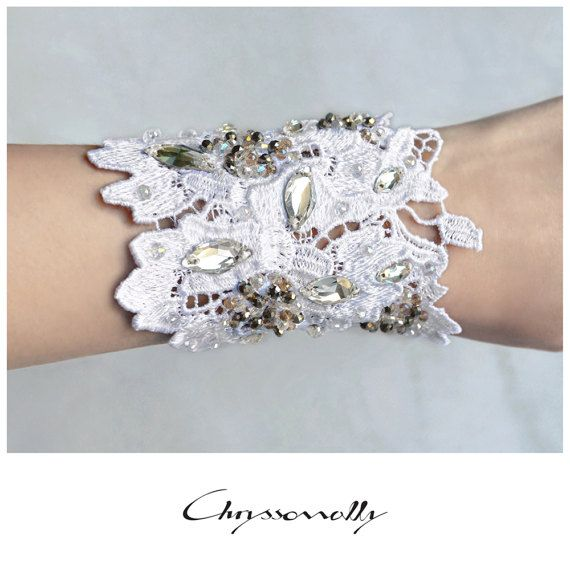 CWC011 - Chryssomally handmade white lace bridal cuff with clear, silver and dusty pink Swarovski crystals.