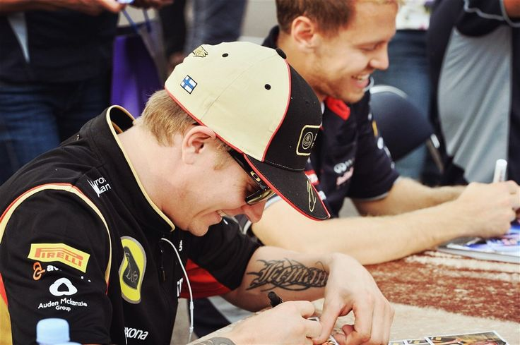 Never seen Kimi so happy at a signing. Must be because Seb is beside him. Best F1 friendship!