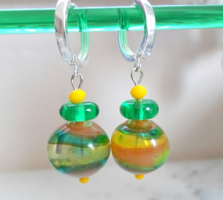 A pair of unique bohemian handblown glass beaded earrings that are light to wear for all seasons, perfect gift for your lady...