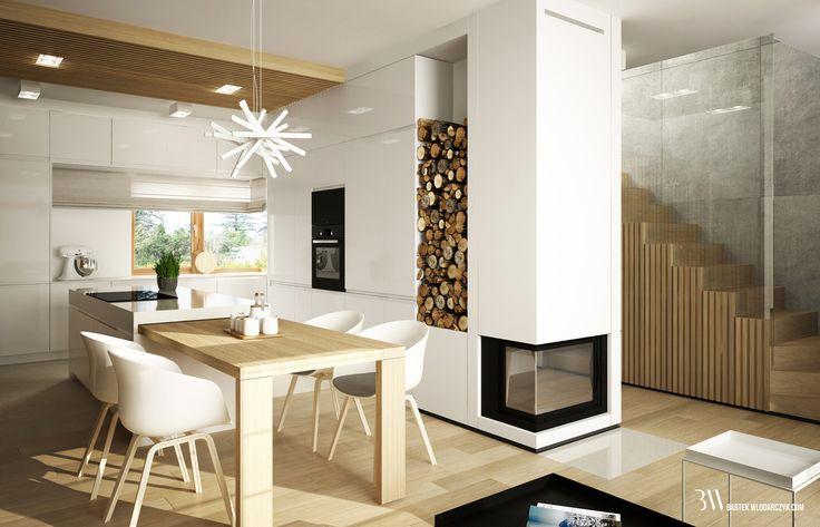Wnętrze domu z kuchnią otwartą na salon z białymi nowoczesnymi meblami. www.bartekwlodarczyk.com