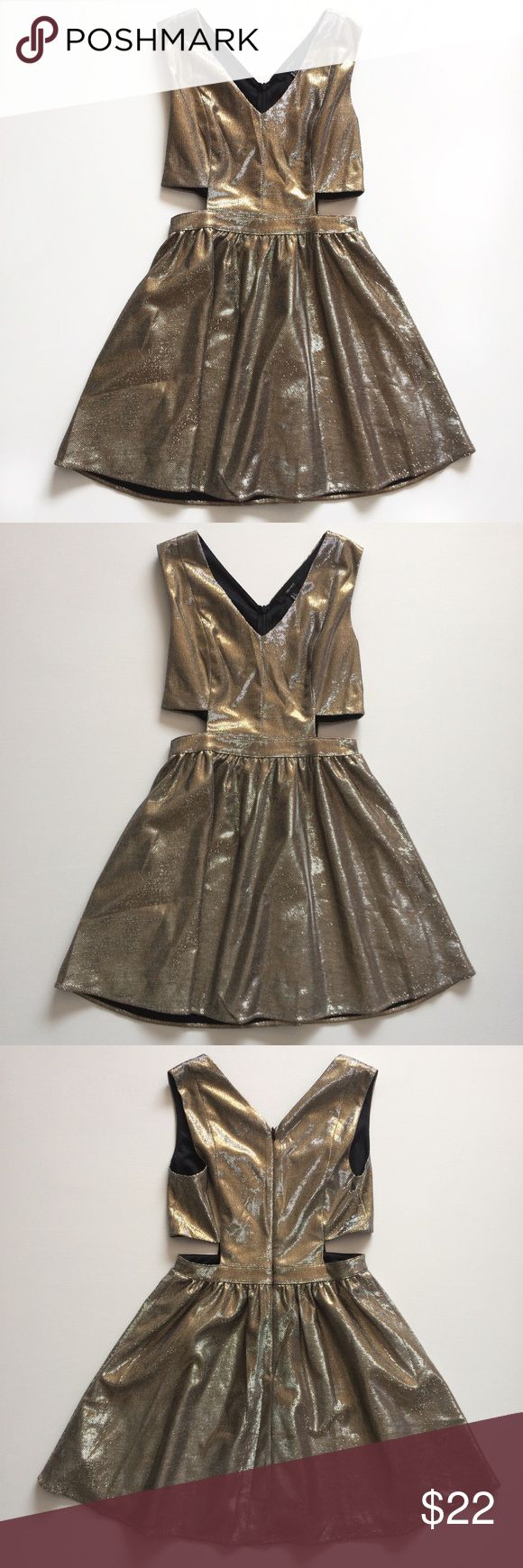 NWOT Forever 21 Metallic Side Cut Out Dress Condition: Only Tried On Size: Small Materials: polyester and metallic yarn Style Recommendation: This is such an adorable gold/silver metallic blend dress with black pumps and accessories for a night out or special event!💕 Forever 21 Dresses