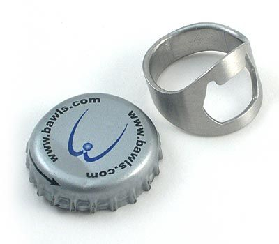 """Travelers have been known to drink a beer or two. But international beer companies haven't yet universally adopted the twist-off cap. The Ring Bottle Opener is worn on your middle finger, with """"cat's ears"""" facing palm. To use: hook bottle cap and lift wrist. Whole ring sizes 8-15, from ThinkGeek.com , $8."""