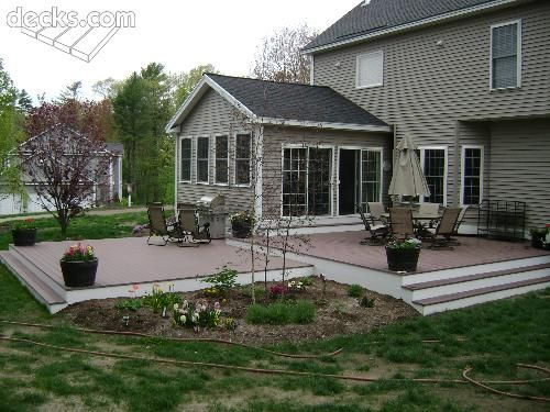 Might look at changing the color of our deck to match something like this.  Spacious platform decks, just outside of a 3 season room, enables outdoor living, rain or shine!