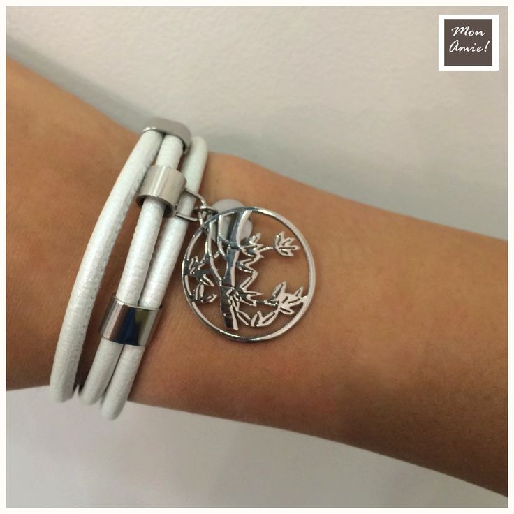 White leather bracelet with metal leaves in a circle