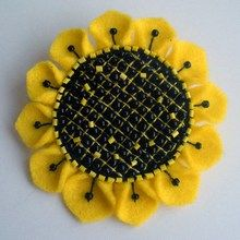 Sunflower brooch made of felt with their hands