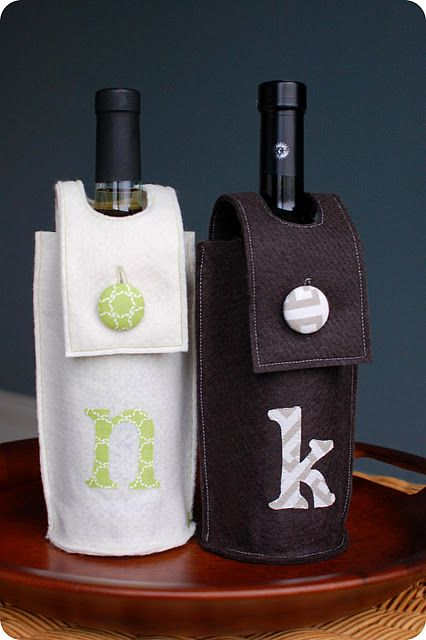 DIY wine holders, great for hostess gifts. Would also be cute made of fabric instead of felt.
