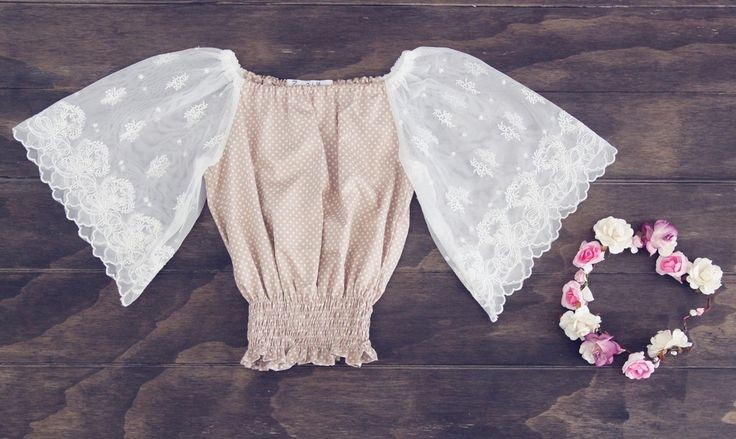 Beautiful bohemian lace top. These gorgeous top is perfect for that free spirited little girl. Featuring beautiful soft lace selves and shirred at the wast.
