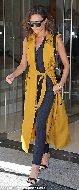 Victoria Beckham wearing clothing from her own collection.