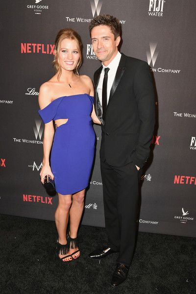 Actors Ashley Hinshaw (L) and Topher Grace at The Weinstein Company and Netflix Golden Globes Party presented with FIJI Water at The Beverly Hilton Hotel on January 8, 2017 in Beverly Hills, California.