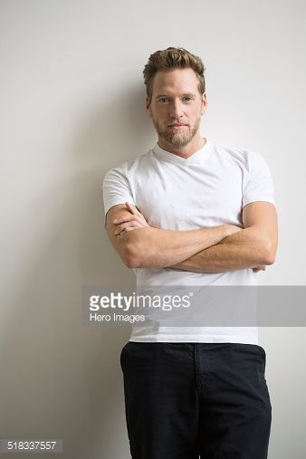 Stock Photo : Portrait of confident blonde man with arms crossed