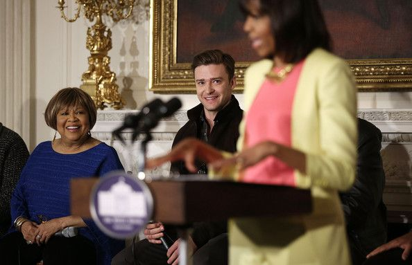 "Justin Timberlake Photos Photos - U.S. first lady Michelle Obama speaks as musicians Mavis Staples (L) and Justin Timberlake (2nd L) listen during an interactive student workshop at the State Dining Room of the White House April 9, 2013 in Washington, DC. The first lady hosted middle and high school students from across the country  to take part in the workshop on ""Soulsville, USA: The History of Memphis Soul."" - Student Music Workshop in Washington, D.C."