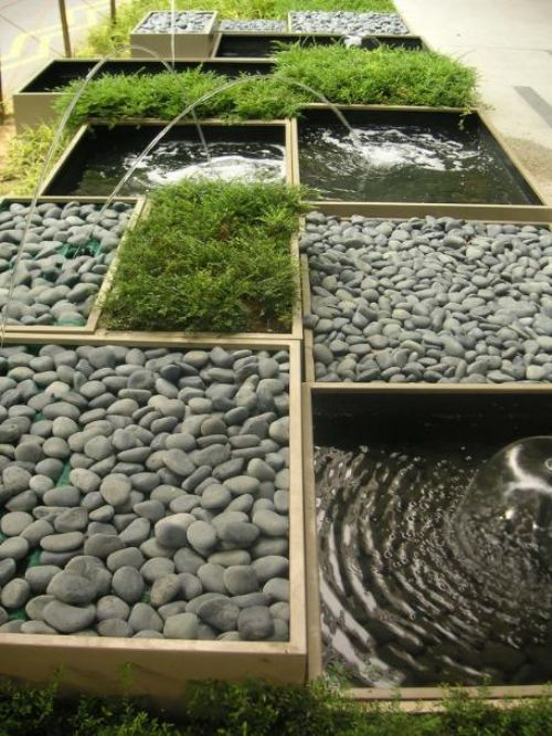 This would look great in a long narrow space, and could even be done on a smaller scale on a small patio or balcony...