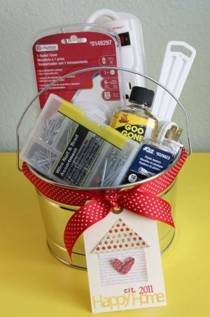 Basket of things for new homeowners - that putty knife is going to be way more useful than another bottle of wine. :)